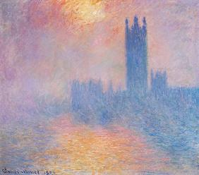 The Houses of Parliament, London. Parlementhuis londen met de zon door de mist
