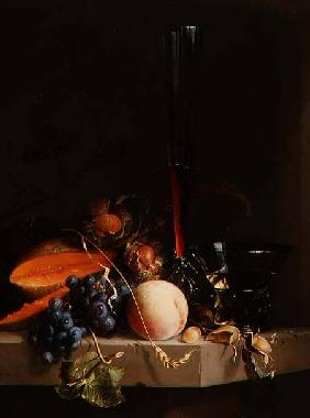 Still life of fruit on a ledge with a roemer and a wine glass