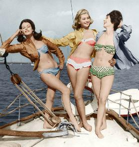 Three young women wearing bikinis colourized document