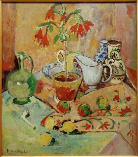 Still life with potted plant and pitchers, fruits and whistle